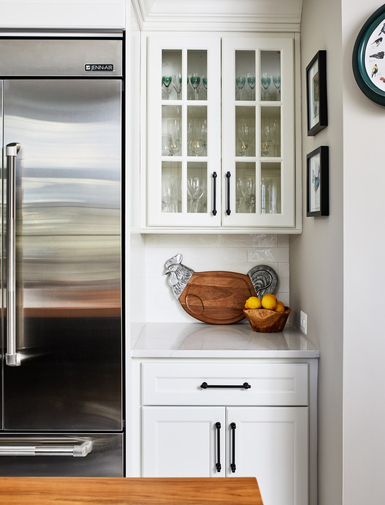 kitchen with stainless steel appliance with glass cabinets doors