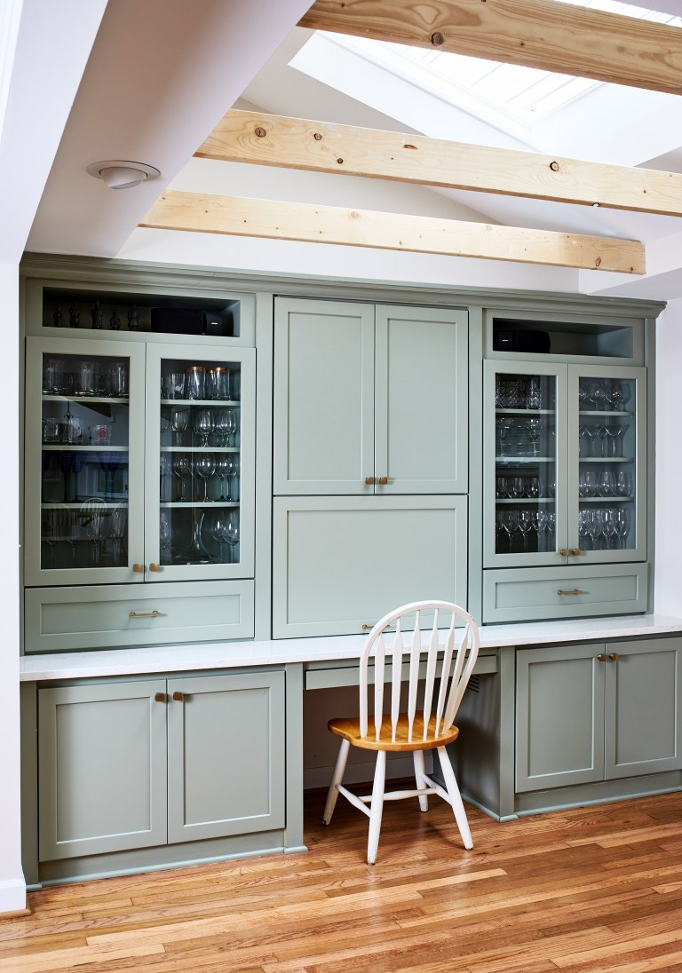 best virginia remodeler kitchen with glass upper cabinets sit on countertops with wood beams and hard wood flooring
