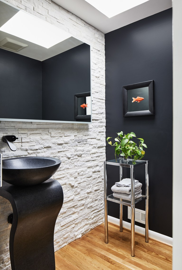 case design build black and white bathroom equipped with a black washstand