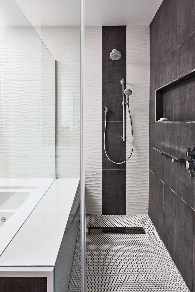 modern style tub with see thru glass and shower