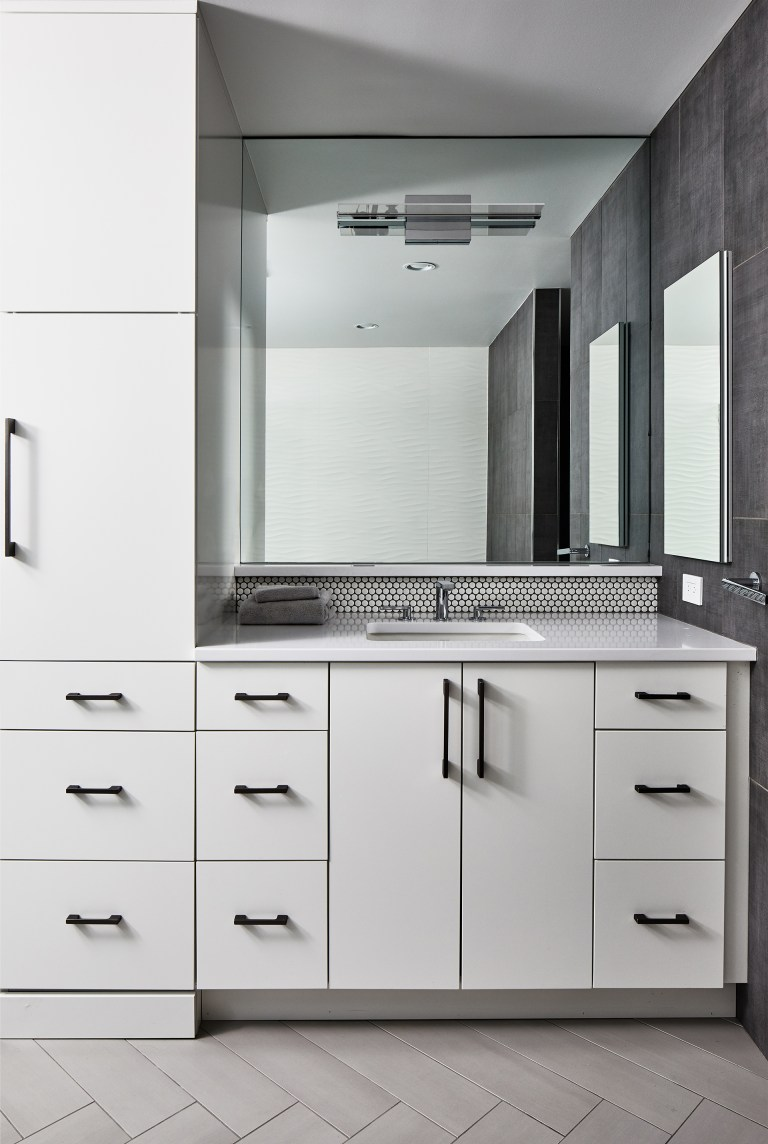 bathroom remodeling companies in Maryland with a white single washstand with mounted mirror