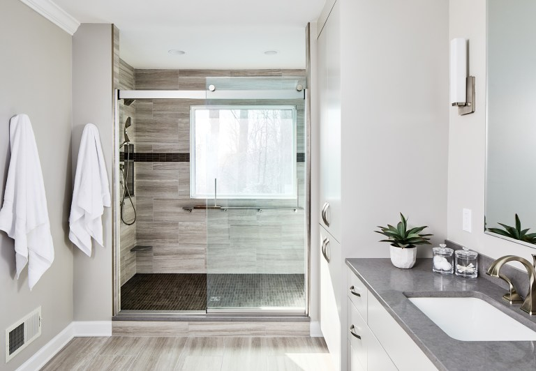 Bathroom remodeling Maryland with large walk-in shower with glass sliding shower door