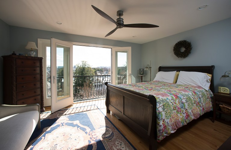 bedroom renovation light blue walls french doors to outside