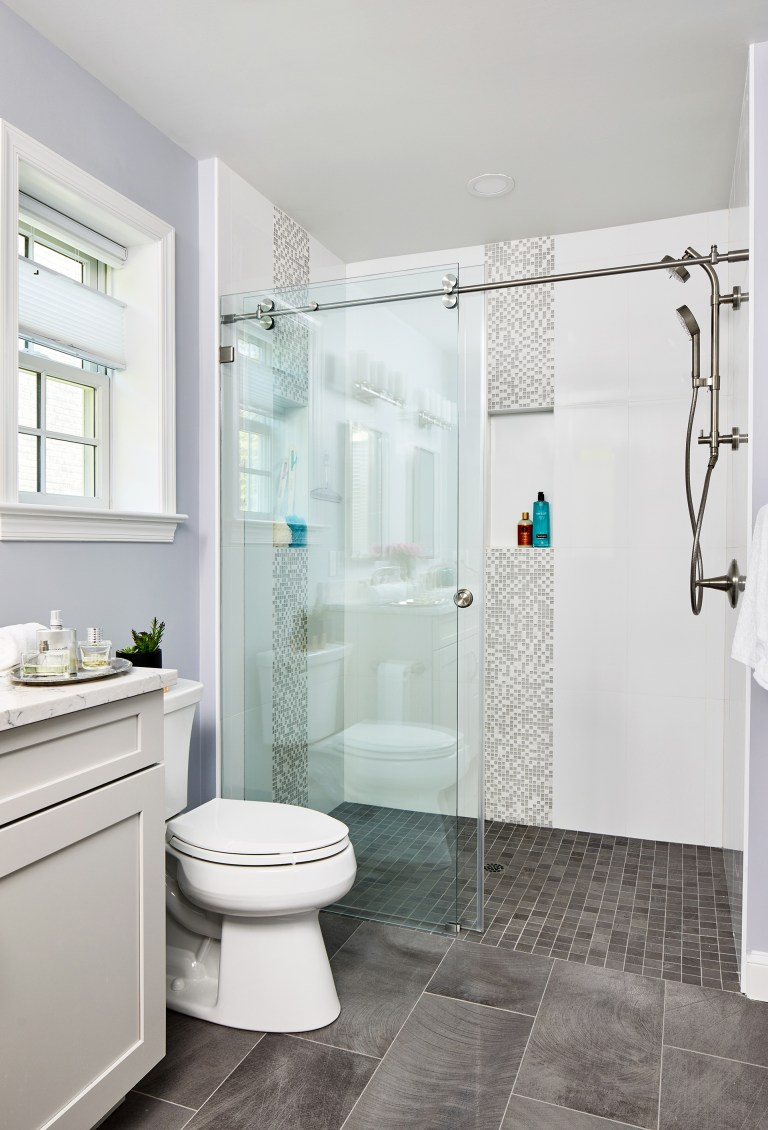 Bathroom with grey floor tile and white gloss ceramic wall tile
