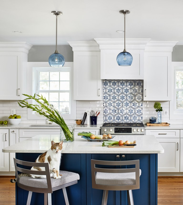 two tall kitchen island chairs with blue shade pendant white and blue backsplash wood floors