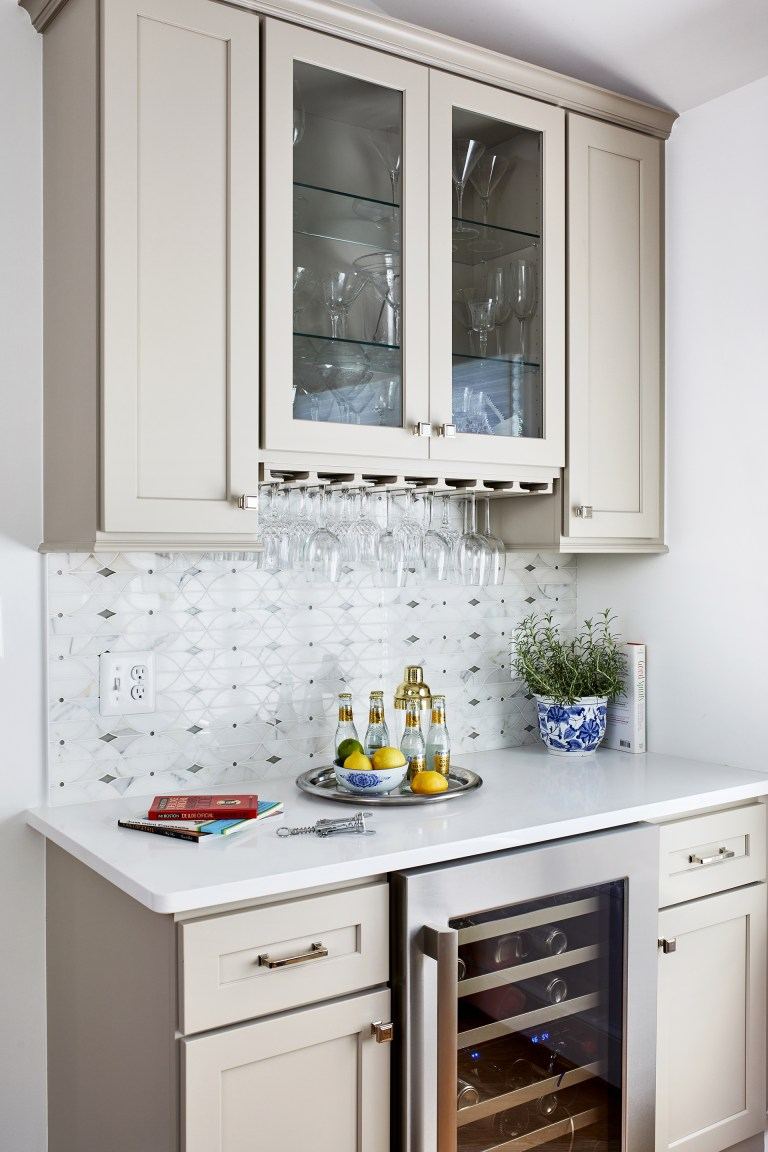 remodeling in Virginia with a white kitchen cabinet with wine refrigerator, as well as glass storage