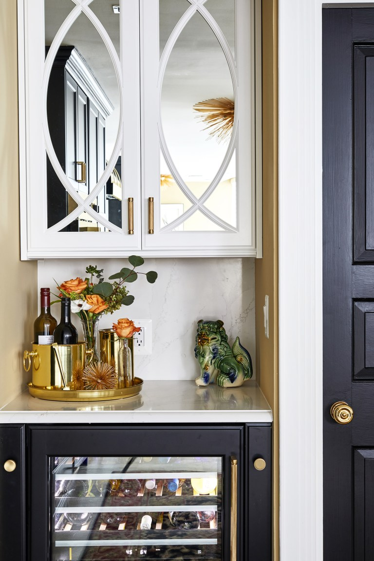 corner mini wine bar with glass white cabinet and gold handles
