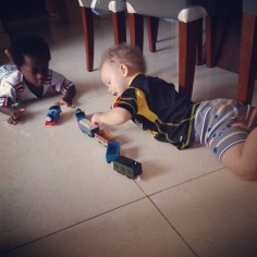Bros play with trains