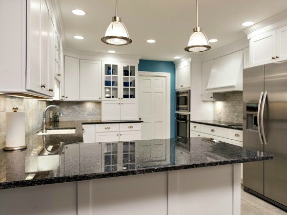 Dated oak cabinets were transformed in this kitchen renovation to bring about the bright white kitchen the clients dreamed of