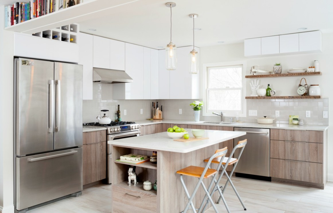 A modern wood grain style kitchen redesign featuring an island with pull up chairs and plenty of nooks for storage