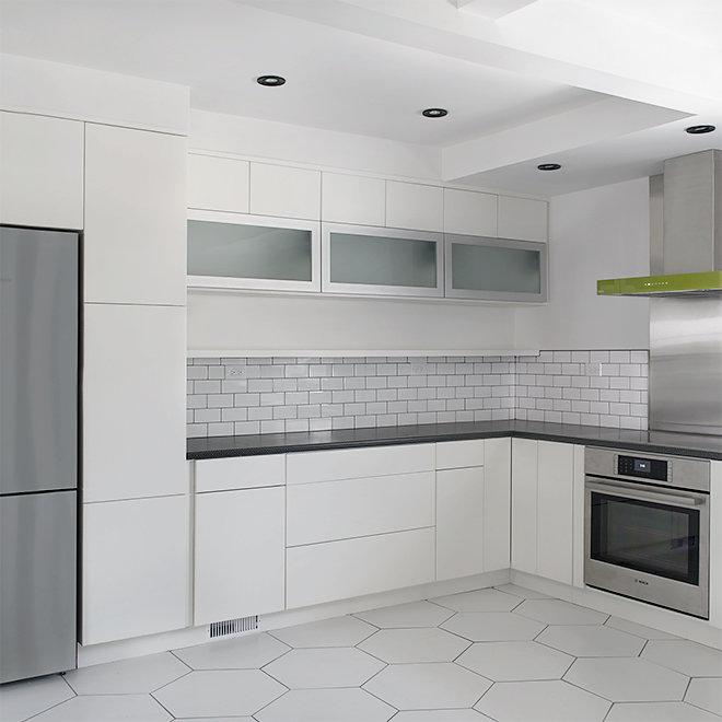 white kitchen open shelves hexagon floor tile subway tile backsplash