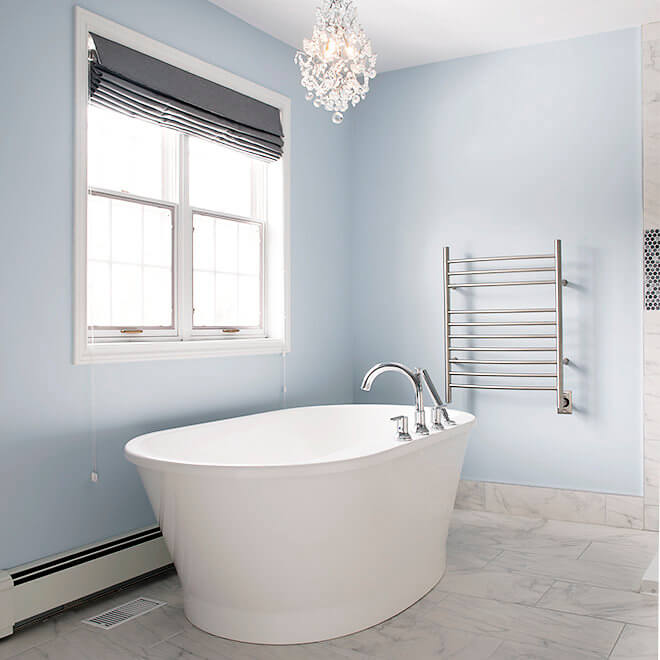 Bathroom renoation with marble tiles White soaker tub chandalier