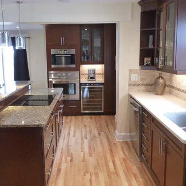 kitchen stone california pizza franchise revitalized open concept case design remodeling wall dark cabinets hardwood floor