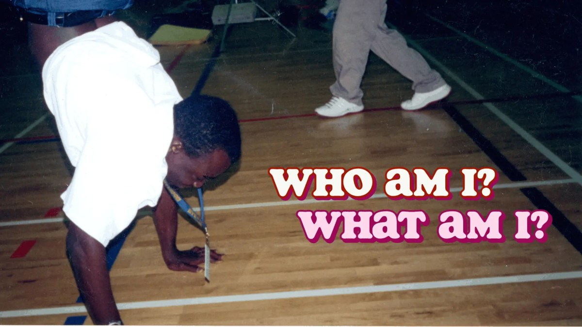 """A photo of me doing breakdancing broncos in the high school cafeteria with the words """"Who Am I? What Am I?"""" overlaid."""