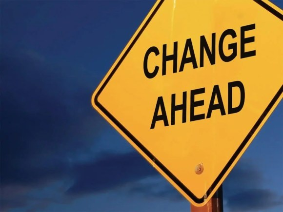 """A road sign reading """"Change Ahead""""."""