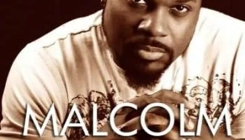 """A picture of Malcolm Jamal-Warner with """"You Have Just Received A Malcolm Jamal Warning"""""""