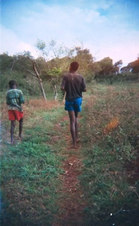 Benty and another relative walking in Jamaica