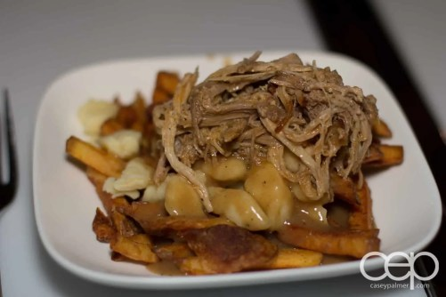 Gourmet Poutine — hand cut yukon fries with cheese curds, pulled pork, and mushroom gravy