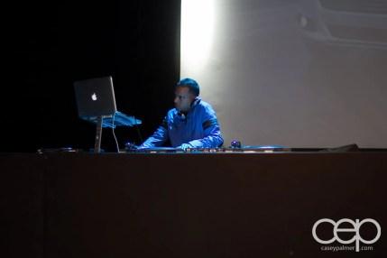 DJ Clymaxxx on the DJ table, spinning some tunes