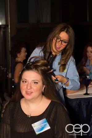 Christine Pantazis getting a makeover at the Ford Blue Party