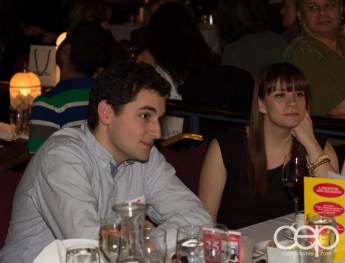 Zach Bussey and Jamie-Leigh Cuthbertson conversing at Table 18 at Mysteriously Yours... Mystery Dinner Theatre