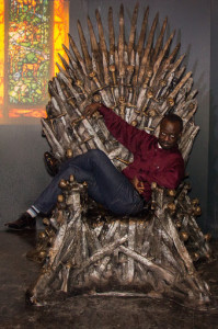 Casey Palmer turns the Iron Throne into a recliner at The Movie Network's Game of Thrones Exhibit