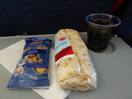 Air Canada breakfast (L-R): Peanuts, Chicken salad wrap, Coca-cola