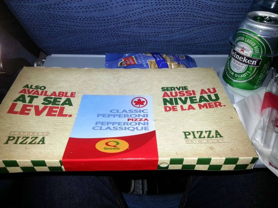 An Air Canada dinner (L-R): Pizza, peanuts and Heineken
