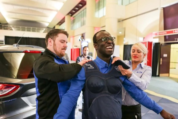 Canadian International Auto Show (CIAS) 2015 — Friday, February 13, 2015 — A Morning With Ford Canada — Casey Palmer Getting Fitted for the Ford Motors Empathy Belly