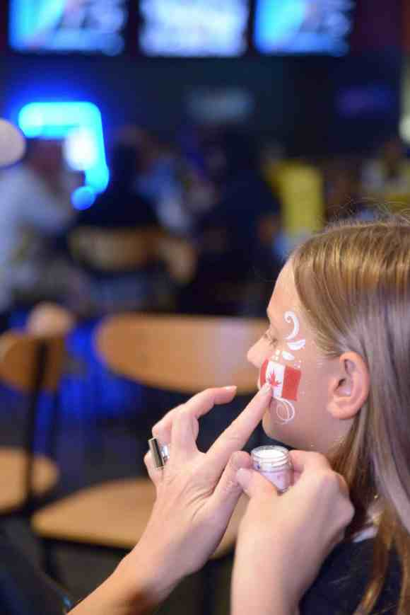 The Fastest Game on Earth Brought to You by Buffalo Wild Wings!—World Cup of Hockey at Buffalo Wild Wings—Face Painting a Girl