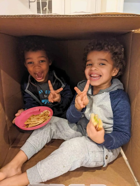 The Palmer boys in their cardboard shed having lunch during the pandemic.