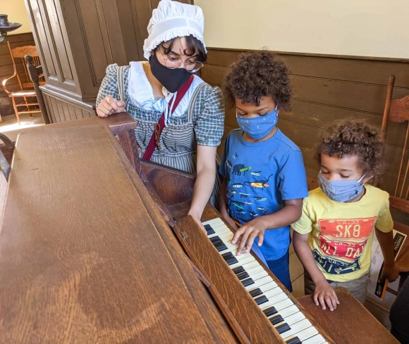 Pickering Museum Village | Examining an Old Piano