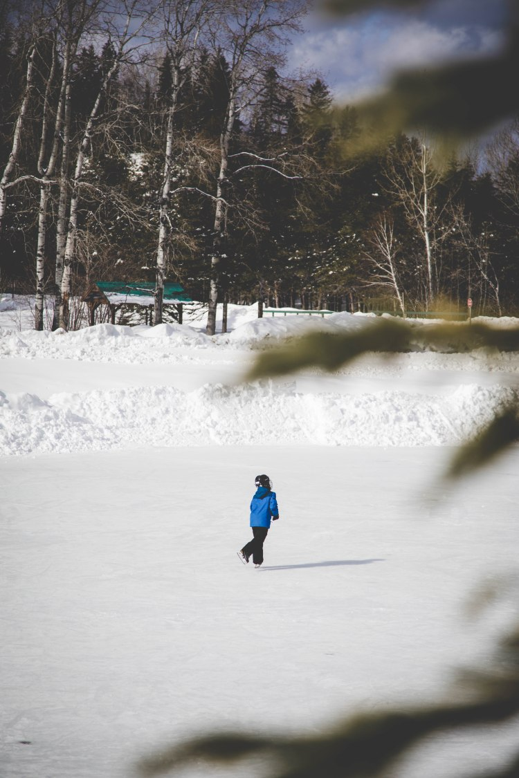 Boy skating on pond at Sugarloaf Provincial Park Campbellton
