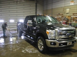 After the Pete was finished, then the white pickup came inside to be washed.  Then, John's black F-350 got the treatment.