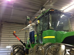 Brandon scrubs the JD 9330 tractor in the shop today.  It once again looks like new.