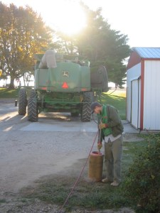 Ben and Brandon are preparing the combines to go to the soybean field.  They are fueling up and cleaning the air filters.