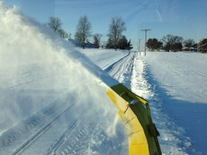 This is what it looks like to use the blower to clear a path down our lane.  Even though it's toasty warm in the tractor, (and 9ºF outside) running backwards for a long time puts a crick in your neck!