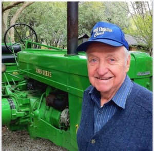 Here's a picture of Howard from a few years ago.  You see two of his life's loves... his church and John Deere green.