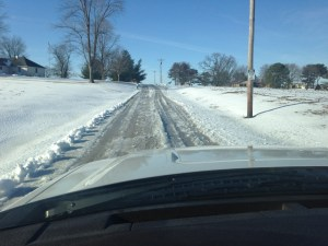 The slushy tracks re-froze last night, making the lane and extra-bumpy ride this morning.