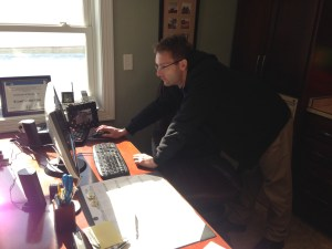 Tim Trotter works his 'magic' on the internet service this morning.