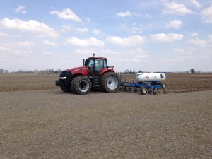 Ross has had a pretty good day applying NH3 at the Burke farm.  He pulls a 15-knife applicator bar, which has about a 40-foot swath.  The rig uses a Raven control system to make the application rate precise.  And, of course, his tractor has AccuGuide, to make his rows straight and the swaths exact.