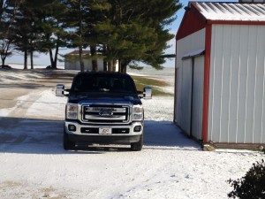 John's pickup sits quietly by the fuel building in the snow.