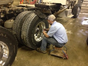Brandon is hard at it making the Pete's wheels shine like new