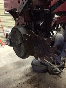 Finally, you see the 'row cleaner' attachment reinstalled up front.  This pair of star-shaped wheels clear the seed trench path of crop residues, making for more accurate placement of the seed.