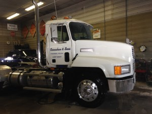 Brandon washes the white Mack truck, the one we call 'Vanna', in this shop today.