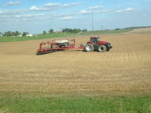 Ross enters the first field of corn planting for 2015.  The C-IH MX 290 and 24-row 1250 planter is  ready to go.