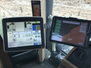Something I check constantly as I'm planting soybeans: The GS 2630 screen on the left, and the iPad with FieldView Cab on the right.