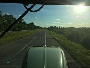 Driving west along US 50, the evening sun streams into the cab.