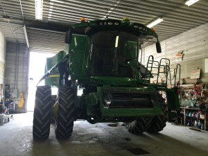 The 680 combine side panels open up to accept the required service.
