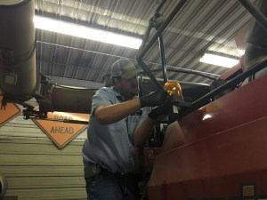 John replaces a bulb in the beacon light on the back of the 8230